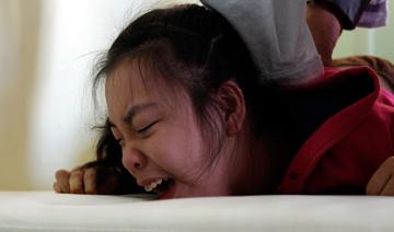 北京:男子和脑瘫双胞胎女儿