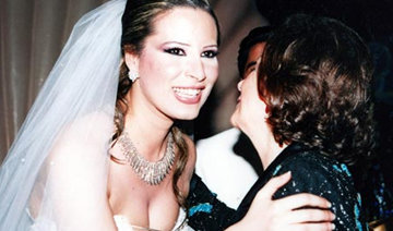 卡扎菲女儿也是时尚潮人 胸前镂空婚纱大胆