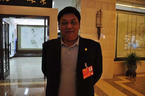 全国人大代表、西藏自治区党委副书记、自治区人大常委会主任白玛赤林(赵晶摄)