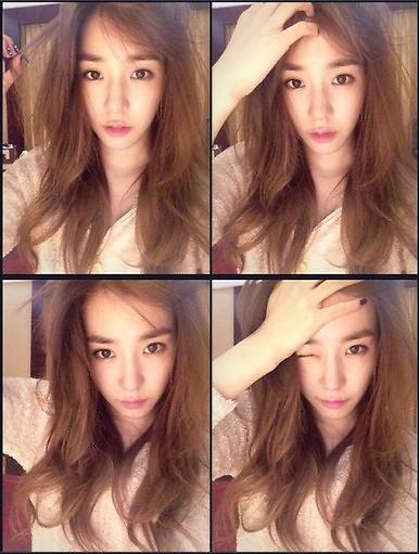 少女时代成员Tiffany晒自拍 头发凌乱自然(图)