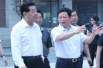 全国政协主席贾庆林听取大唐西市公司董事长吕建中介绍大唐西市项目