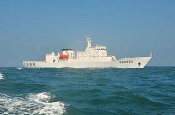中国渔政310在南海逼退三艘外国炮艇