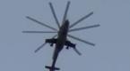 男子阳台上拍直升机 被丢下2枚炸弹炸在脚边