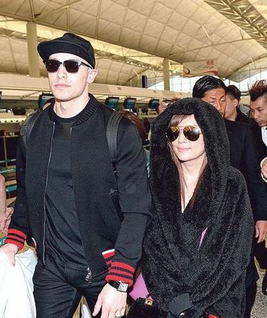 [明星爆料]滨崎步戴黑超素颜现身机场 与老公并肩而行(图)