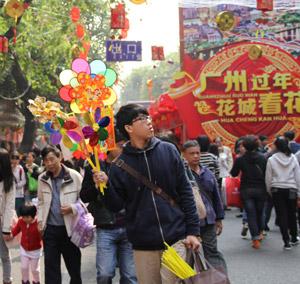 广州迎春花市:行过花街才过年