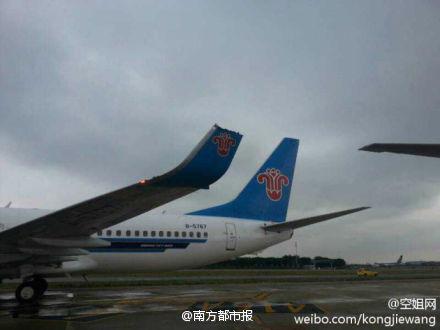 广州白云机场南航刮蹭东航飞机