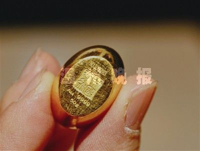 中国黄金9999金元宝.(图片来源:温州网)