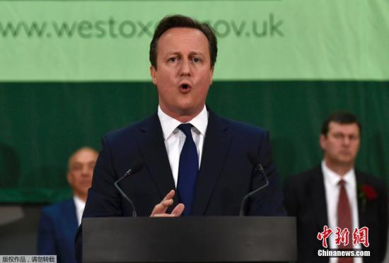 资料图:英国首相卡梅伦。