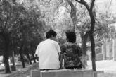 七十年代末八十年代初,年轻人结婚办理结婚证时,可以领取购买一件家具的票证,凭票证领号排一夜的队,就可以买到一件家具。这是一对新婚夫妇买到家具回家的情景。摄于一九八零年夏。