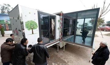 重庆4男子合资30万建移动别墅