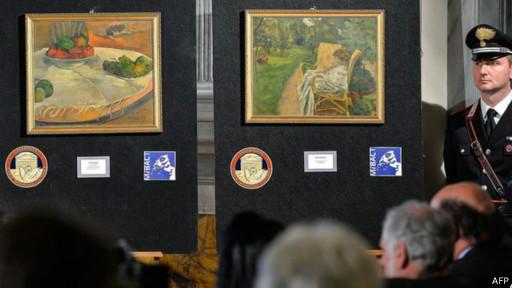 图为失窃的两幅名画。