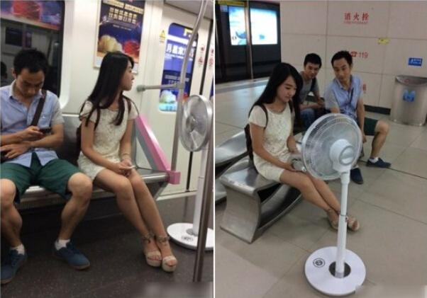 自带无绳电扇乘地铁的美女