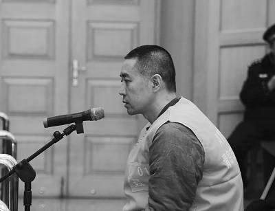 聂磊在受审。青岛市中级人民法院供图
