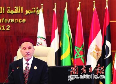 """29日,在伊拉克首都巴格达,利比亚""""全国过渡委员会""""主席贾利勒出席阿拉伯国家联盟(阿盟)峰会。新华社发src=""""http://y0.ifengimg.com/news_spider/dci_2012/03/6ebba7d36da44ce9a12eff6057736de3.jpg"""""""